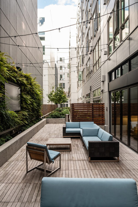 Outdoor lounge with living wall and a huge TV