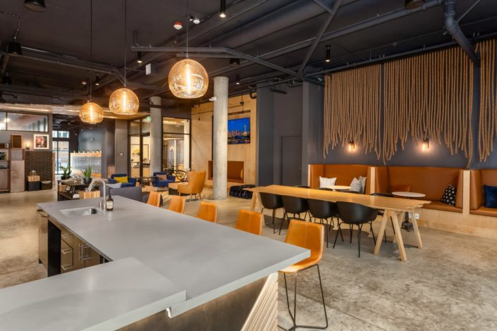 The social lounge at Jack Apartments has a lot of space, chairs and tables to entertain your friends and guests.