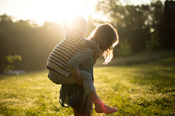 kids playing outside with natural sunlight