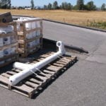 Custom Pipes and Pipe Fittings strapped to a pallet to ship.