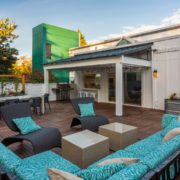 The rooftop patio features couches, chairs and tables.