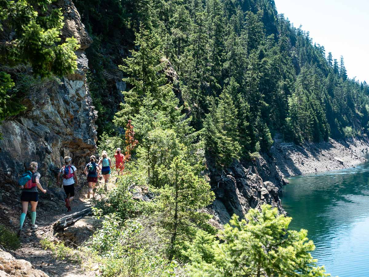 trail runners alongside Ross Lake in the North Cascades