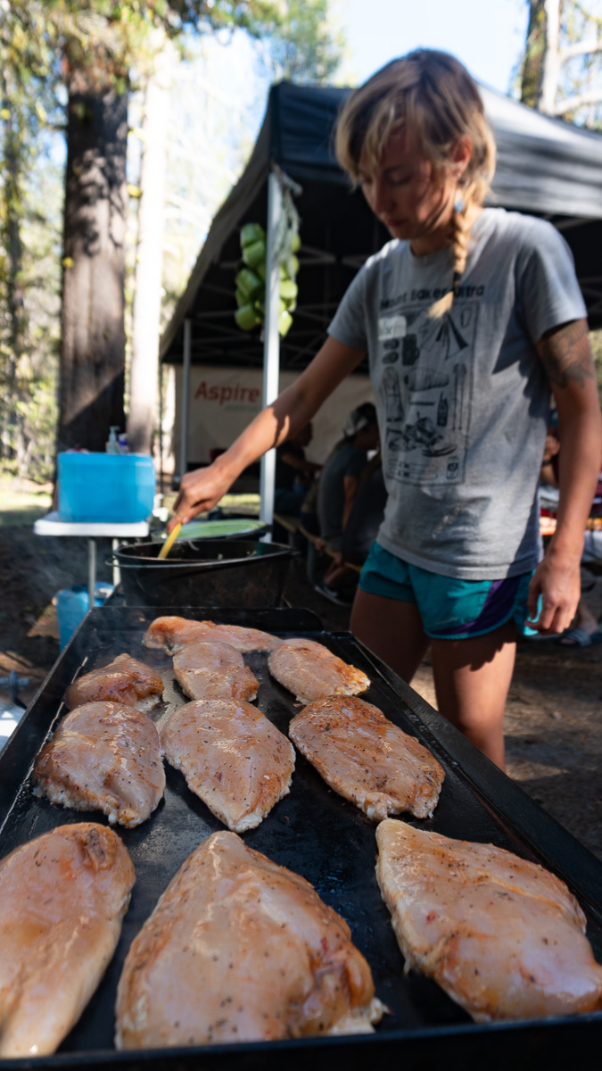 a woman grilling chicken