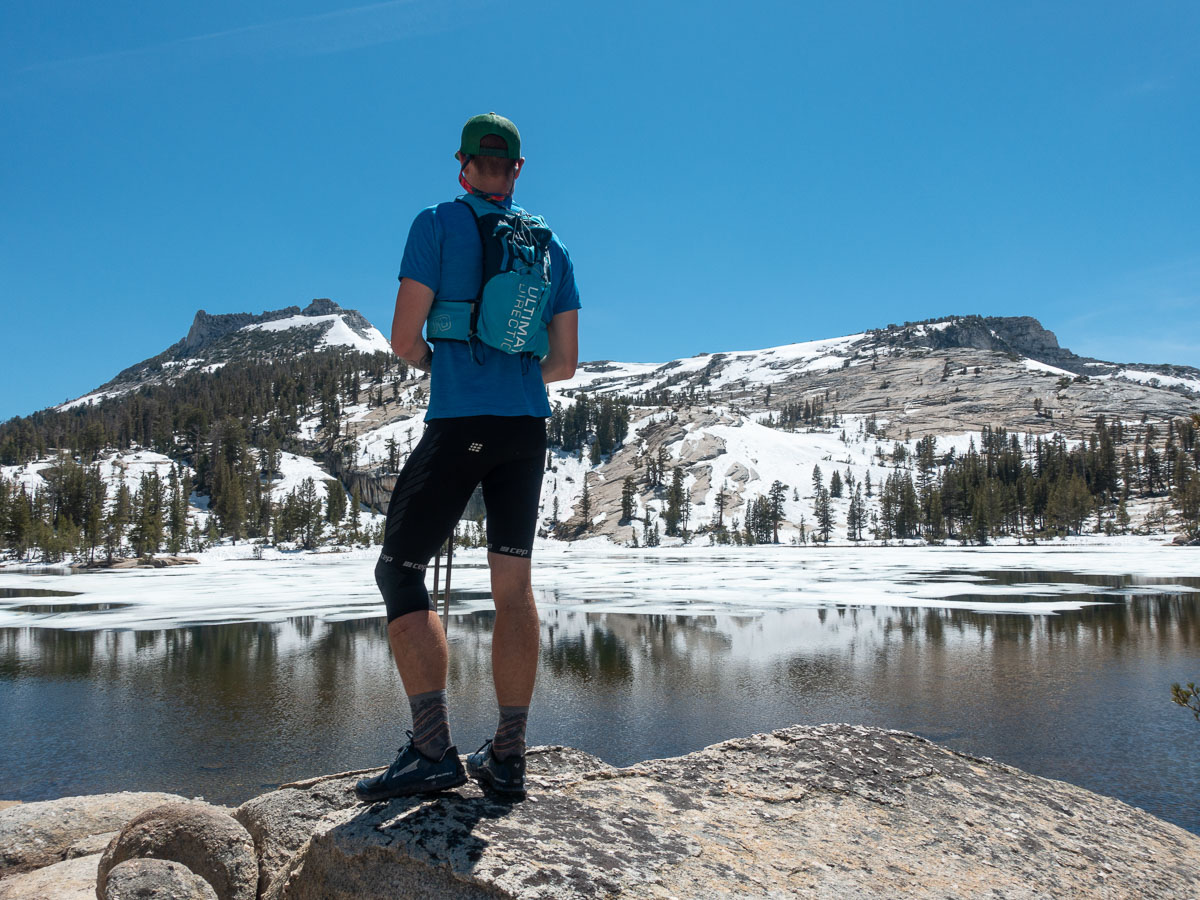 A man gazes over an alpine lake in the High Sierra