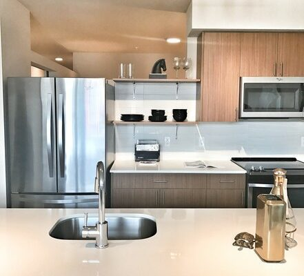 View of the kitchen at the Hayes on Stone Way that has modern cabinetry and a large island