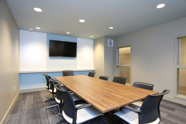 Business center at our Fremont Seattle apartments with a large conference table surround by chairs